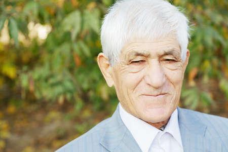 hoariness: Portrait of positive senior man in formal wear
