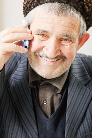 hoariness: Smiling senior with cellphone closeup photo
