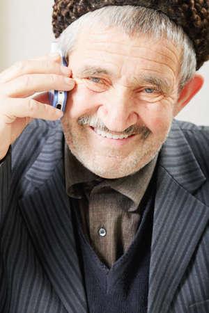 grayness: Smiling senior with cellphone closeup photo