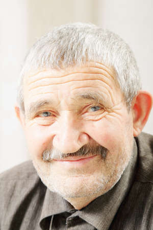 hoariness: Facial portrait of content senior man Stock Photo
