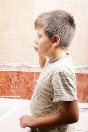 Boy in bathroom brushing teeth at basin Stock Photo - 9589491