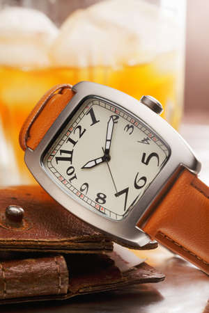 New wristwatch and old rusty wallet closeup Stock Photo