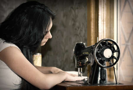 Young caucasian female tailor at work