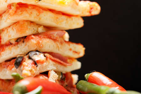 Stacked pizza and chili closeup with space for copy Stock Photo