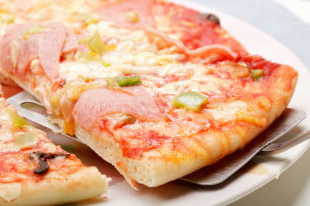 thawing: Slice of pizza on spatula above view closeup shot Stock Photo