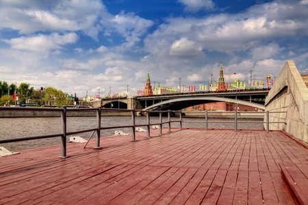sightseeng: At Moscow river on wooden berth in sunny day