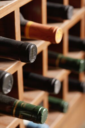 Wine bottles in wooden rack cells
