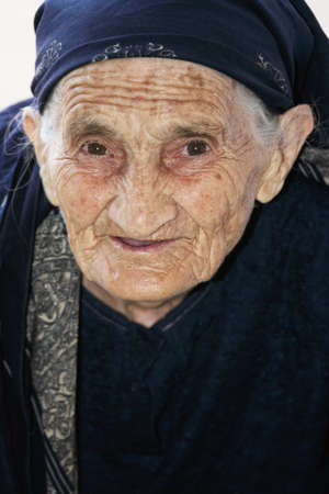 Senior woman in blue shawl and dress closeup photo
