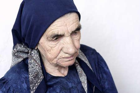 looking sideways: Serious senior woman looking sideways