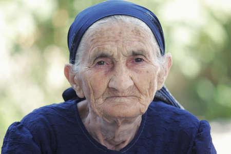 Strong senior woman closeup portrait photo