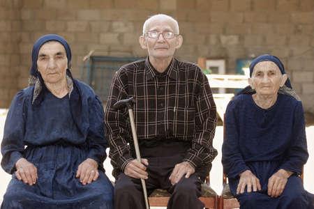Seniors family portrait taken outdoors photo
