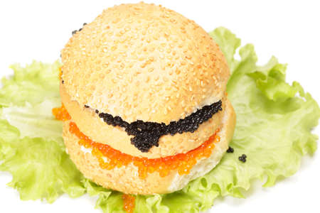 Red and black caviar sandwich over white above view photo