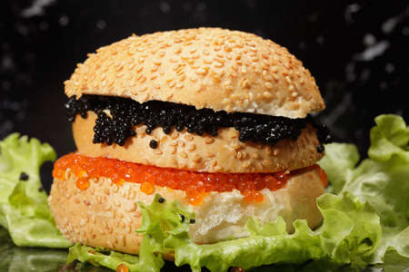 Red and black caviar sandwich on lettuce photo