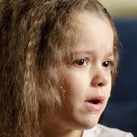 Crying girl looking sideways closeup photo photo