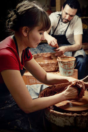 Male and female potters at work Stock Photo