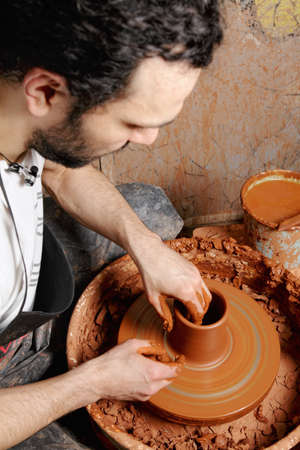 Potter at work on wheel making jug above view Stock Photo - 11870443