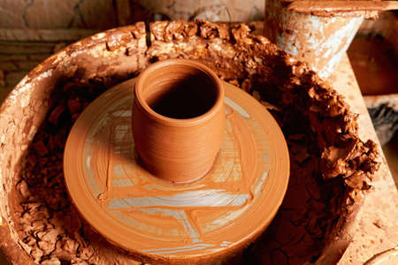 Jug on potter wheel closeup photo photo