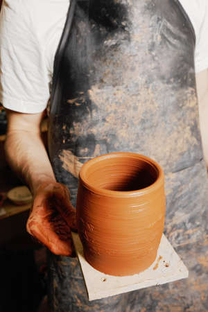 Hand of potter with jug closeup photo photo