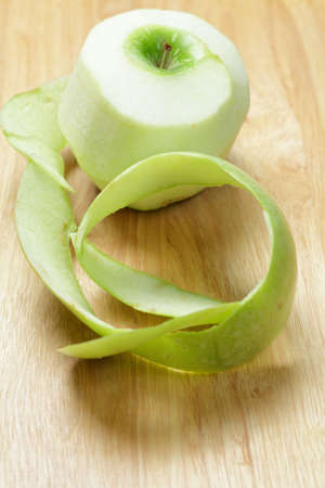 Apple peel on wooden cutting board