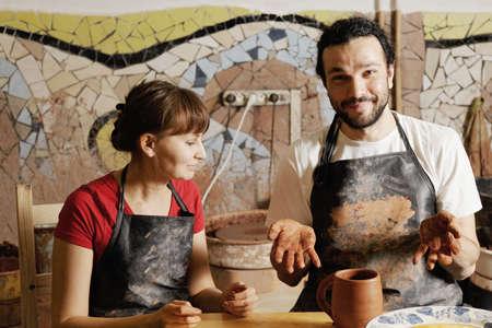 potter: Positive potters in workshop showing jug Stock Photo