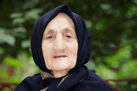 Confident senior woman against green leaves outdoor portrait Stock Photo - 13052481