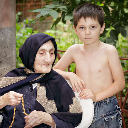 Great-grandson with great-granny outdoors photo