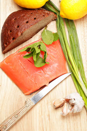 Salmon fish with bread and vegetables above view photo