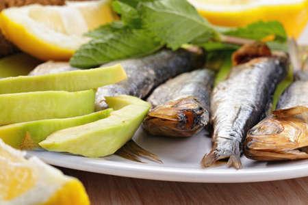 sprat: Smoked sprat fish with avocado and lemon