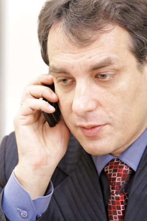 Middle aged businessman on phone closeup photo photo