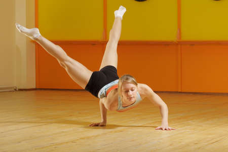 Powerful blonde training gymnastics in gym Stock Photo - 14204201