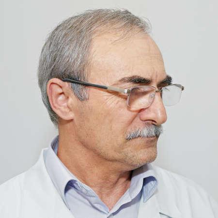 looking sideways: Portrait of serious doctor looking sideways