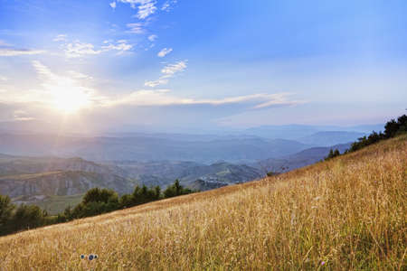 Sun rays in Caucasus mountains with clouds in blue sky Stock Photo - 15560704