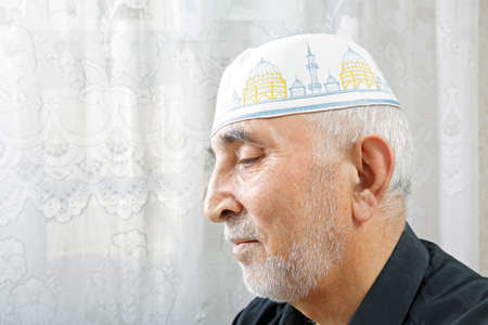Senior man in religious hat profile view portrait photo