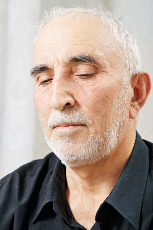 grayness: Portrait of pensive senior man lost in thoughts