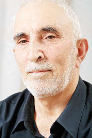 hoariness: Portrait of serious senior man in black shirt Stock Photo