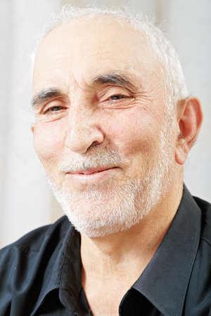 hoariness: Portrait of smiling senior man in black shirt Stock Photo