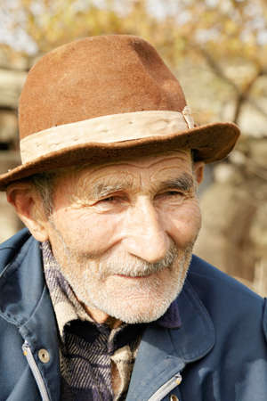 Senior man in hat looking sideways Stock Photo - 15867326
