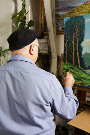 Artist at work painting picture in workshop rear view Stock Photo - 15862901