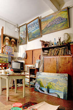 Artistic studio interior with pictures hanging on walls photo