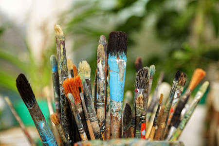 soiled: Various paintbrushes soiled with paints closeup photo