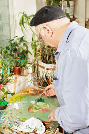 Painter mixing paints on palette sideview Stock Photo - 15862905