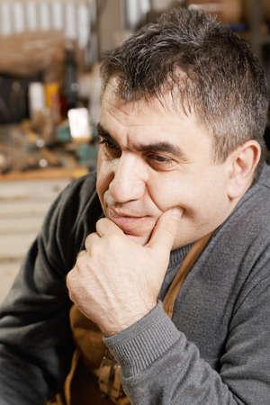 looking sideways: Portrait of middle-aged caucasian man in apron looking sideways Stock Photo