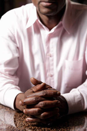 Folded hands of a guy in pink shirt Stock Photo - 16142270