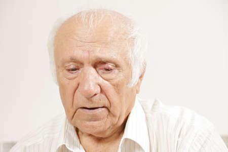 Senior pensive man in white shirt looking down Stock Photo - 16469186