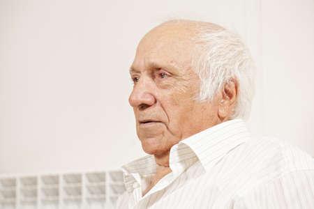 hoariness: Senior man in white shirt sideview