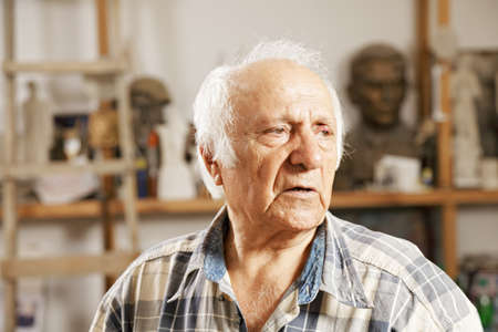 sculptor: Portrait of senior man in sculptor workshop Stock Photo