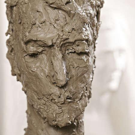 Head sculpture against woman relief closeup Stock Photo - 16469189