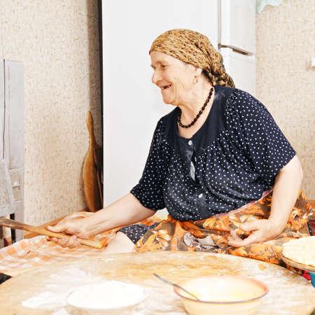 looking sideways: Happy senior woman at kitchen looking sideways
