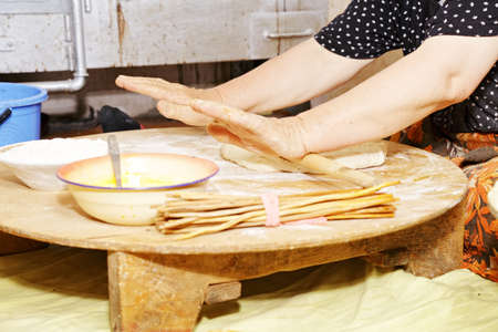 Senior woman hands rolling the dough out to make bread Stock Photo - 16731612