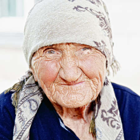 Senior woman in shawl closeup portrait